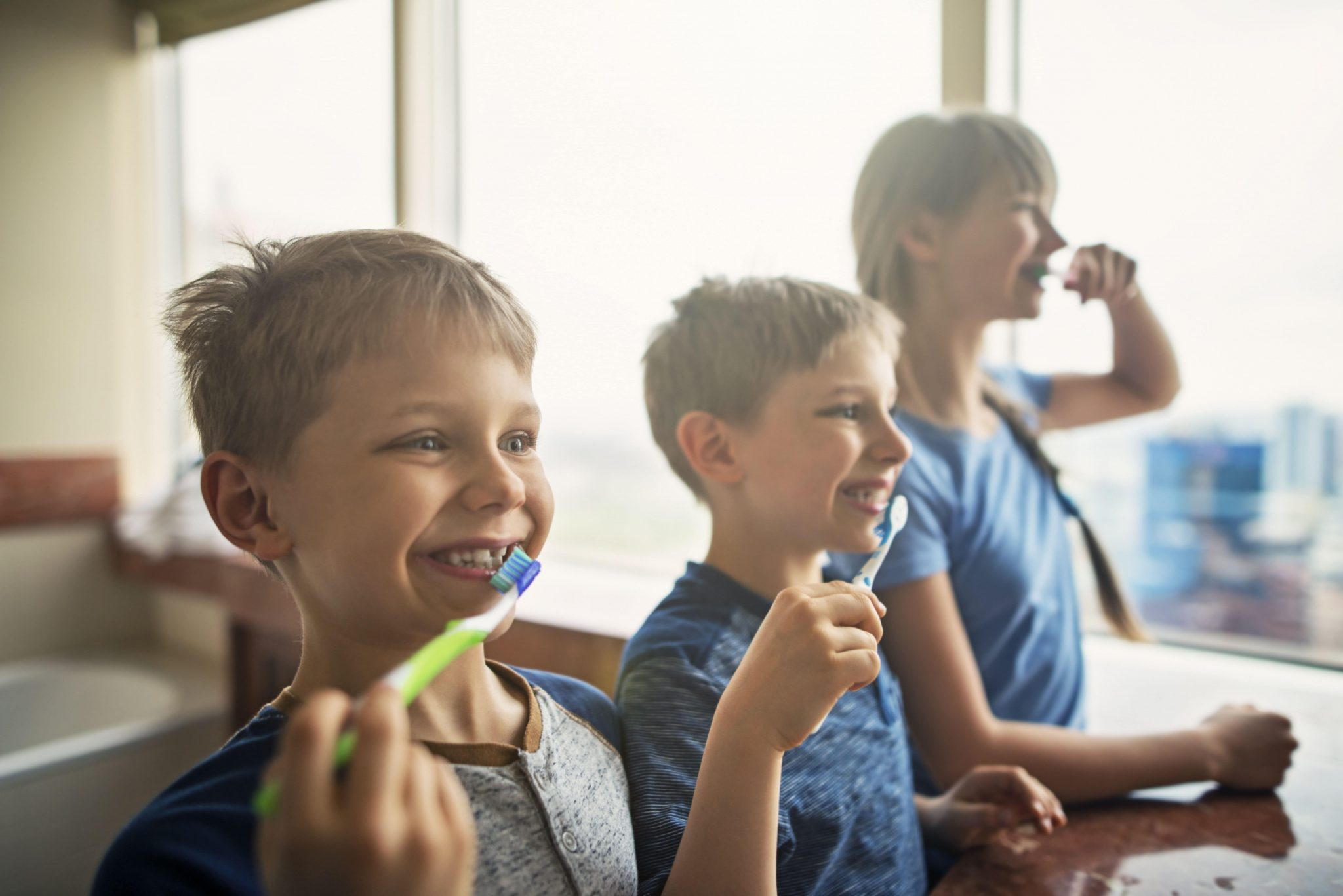 Rosenthal Family Dentistry Three Children Brushing Their Teeth