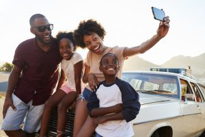 Rosenthal Family Of Four Taking A Selfie Atop A Car