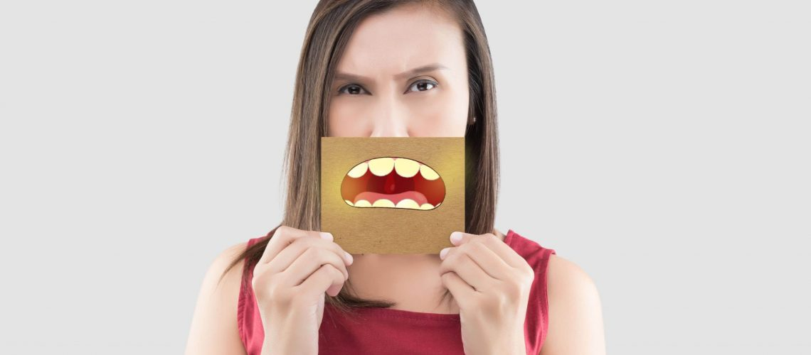Rosenthal Family Dentistry- Woman with Bad Breath sign